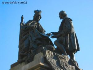 Columbus kneeling before the Spanish queen.