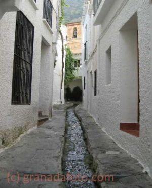 Water flowing through Street in Pampaneira